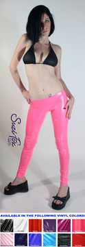 Womens Leggings shown in Neon Pink Gloss vinyl/PVC, custom made by Suzi Fox.  Super Low rise shown. You can order this in almost any fabric on this site.  • Custom made to your measurements! • Available in black, red, white, light pink, neon pink, fuchsia, purple, royal blue, navy blue, turquoise, black matte (no shine), white matte (no shine) stretch vinyl coated spandex. • 1 inch elastic at the waist. • Optional 1 or 2-slider crotch zipper. • Optional ankle zippers • Optional rear patch pockets • Optional belt loops • Made in the U.S.A.