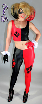 Harley Quinn Leggings shown in Black & Red Wet Look Lycra Spandex, custom made by Suzi Fox.  You can order this in almost any fabric on this site.  • Available in black, white, red, turquoise, navy blue, royal blue, hot pink, lime green, green, yellow, steel gray, neon orange Wet Look. • Shown with optional tank top, and gloves. • Custom made to your measurements! • 4 diamonds on each leg • 1 inch elastic at the waist. • Optional 1 or 2-slider crotch zipper. • Optional ankle zippers • Optional rear patch pockets • Optional belt loops • Made in the U.S.A.