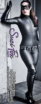 """Custom DKR (Dark Knight Rises) Catwoman Catsuit Costume by Suzi Fox shown in Black Matte (no shine) Vinyl/PVC coated Nylon Spandex.  Includes gloves & leather mask. • Available in black, red, white, light pink, neon pink, fuchsia, purple, royal blue, navy blue, turquoise, black matte (no shine), white matte (no shine) stretch vinyl coated spandex, or any fabric on this site. • Your choice of front or back zipper (front zipper shown). • Optional 1 or 2-slider crotch zipper, and """"Selene"""" from Underworld TS Brass zipper, or aluminum circular slider zipper like Catwoman comic characters. • Optional wrist zippers • Optional ankle zippers • Optional finger loops • Made in the U.S.A."""