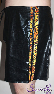 Mens Basketball or Board shorts shown in Black Faux Leather Metallic Foil with Leopard print stripes, custom made by Suzi Fox. • Available in gold, silver, copper, gunmetal, turquoise, Royal blue, red, green, purple, fuchsia, black faux leather/rubber Metallic Foil, and any fabric on this site. • 1 inch no-roll elastic at the waist. • Optional belt loops. • Optional rear patch pockets. • Optional drawstring. • Made in the U.S.A.