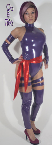 "Psylocke Costume shown in gloss Purple Vinyl/PVC, custom made by Suzi Fox.  You can order this costume in almost any fabric on this site.  Costume includes 4 arm bands, 4 leg garters, bird finger gloves, red sash. • Available in gloss black, white, red, neon pink, light pink, fuchsia, purple, royal blue, navy blue, turquoise; matte (no shine) black, matte (no shine) white. This fabric is a 4-way stretch, vinyl/PVC coated spandex. • Optional Bust Cutout • Your choice of rears - French legs (Rio), Cheeky, Full, or Thong. • Optional 1 or 2-slider crotch zipper • Optional ""Selene"" from Underworld TS zipper • Optional aluminum circular slider zipper like Catwoman comic characters. • Optional rear patch pockets • Made in the U.S.A."