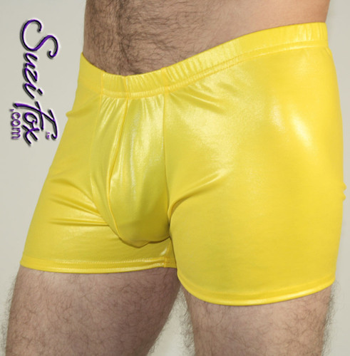 Pouch Front shorts or underwear shown in Yellow Wetlook Lycra Spandex, custom made by Suzi Fox. Custom made to your measurements! Choose your pouch size. • Wear them as shorts, swimwear, or underwear. • Available in black, white, red, turquoise, navy blue, royal blue, hot pink, lime green, green, yellow, steel gray, neon orange Wet Look and any fabric on this site. • 1 inch no-roll elastic at the waist. • Optional belt loops. • Optional rear patch pockets. • Your choice of inseam. 2 inch inseam shown. Made in the U.S.A.