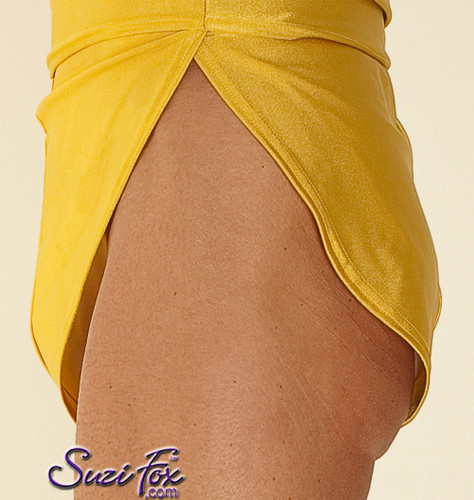 """Men's V front, Split Side Running/ Cover-Up Shorts shown in Athletic Gold Milliskin Tricot Spandex, custom made by Suzi Fox. • Available in black, white, red, royal blue, sky blue, turquoise, purple, green, neon green, hunter green, neon pink, neon orange, athletic gold, lemon yellow, steel gray Miilliskin Tricot spandex, and any fabric on this site. • 1 inch no-roll elastic at the waist. • Front inside pouch. • The A15's are a """"V"""" shape in the front, with less fabric on the front of the leg, and a very thin crotch. Commonly worn by runners and marathon participants, the A15's offer less chafing between the legs and does not inhibit the legs. • Made in the U.S.A."""