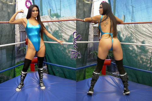 Womens One Piece T-back Thong Swim Suit shown in Turquoise Metallic foil Spandex, custom made by Suzi Fox. • Custom made to your measurements. • The high leg hole, low back and t-back thong rear create a stunning and sexy suit. • Available in gold, silver, copper, gunmetal, turquoise, Royal blue, red, green, purple, fuchsia, black faux leather/rubber Metallic Foil, and any fabric on this site. • Made in the U.S.A.