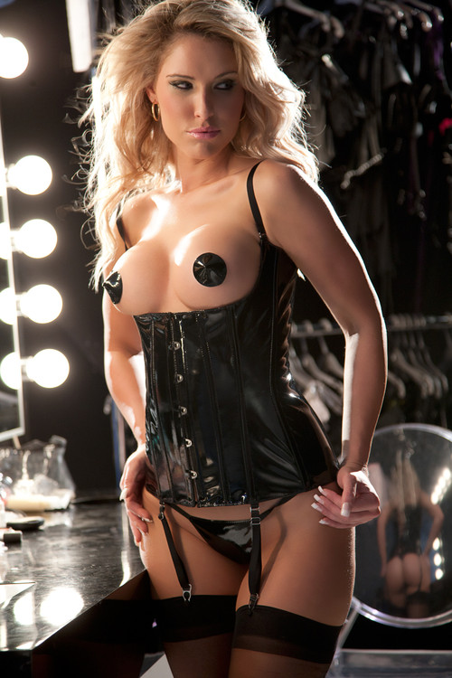 "Allure Leather ""Sara's"" Sultry Vinyl Corset  Slick and sexy, this revealing vinyl corset is sure to make them melt. And with detachable shoulder straps and garters, it can be worn in a number of ways – in or out of the bedroom. Boning. Front busk opening. Lace-up back. Adjustable shoulder straps.  G-STRING INCLUDED"