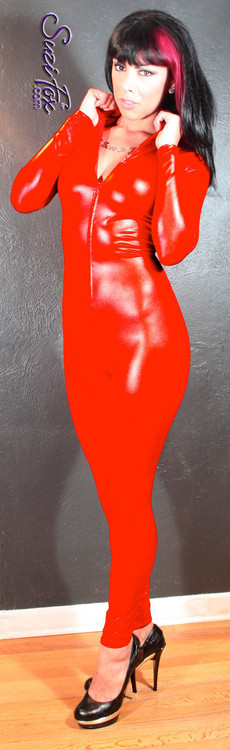 """Custom Catsuit by Suzi Fox shown in Red Wet Look Lycra Spandex.  You can order this Catsuit in almost any fabric on this site.  • Available in black, red, white, turquoise, navy blue, hot pink, lime green, green, yellow, royal blue, steel gray, neon orange. This is a 4-way stretch fabric with a medium shine. • Your choice of front or back zipper (front zipper shown). • Optional 1 or 2-slider crotch zipper, and """"Selene"""" from Underworld TS Brass zipper, or aluminum circular slider zipper like Catwoman comic characters. • Optional wrist zippers • Optional ankle zippers • Optional finger loops • Optional rear patch pockets • Made in the U.S.A."""