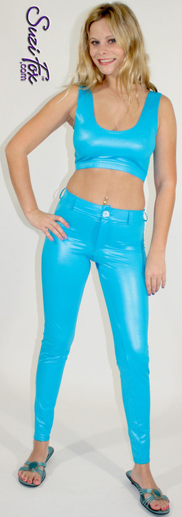 Womens Jean style pants shown in Turquoise Wet Look Lycra Spandex, custom made by Suzi Fox. • Choose any fabric on this site, including vinyl/PVC, metallic foil, metallic mystique, wetlook lycra Spandex, Milliskin Tricot Spandex. • Waistband, Button and front fly zipper. • Standard rear patch pockets. • Standard belt loops. • Optional ankle zippers.