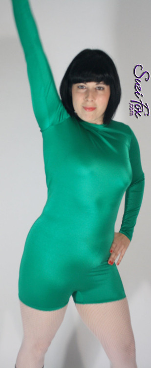 "Womens Romper Catsuit shown in Green Shiny Milliskin Tricot spandex, custom made by Suzi Fox.  You can order this Romper in almost any fabric on this site.  • Available in black, white, red, royal blue, sky blue, turquoise, purple, green, neon green, hunter green, neon pink, neon orange, athletic gold, lemon yellow, steel gray Miilliskin Tricot spandex. • Standard inseam: 2 inches (5.1 cm) • Your choice of front or back zipper (back zipper shown). • Optional 1 or 2-slider crotch zipper, and ""Selene"" from Underworld TS Brass zipper, or aluminum circular slider zipper like Catwoman comic characters. • Optional wrist zippers. • Made in the U.S.A."