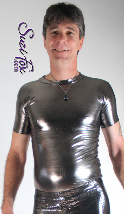 Mens Tee Shirt shown in Gunmetal Metallic Foil Spandex, custom made by Suzi Fox. • Available in gold, silver, copper, gunmetal, turquoise, Royal blue, red, green, purple, fuchsia, black faux leather/rubber Metallic Foil, and any fabric on this site. • Choose your sleeve length. • Give us your measurements for a custom fit! • Standard length is 24 inches (61 cm) for sizes XXXS-Medium; 27 inches (68.6 cm) for sizes Large and up. • Optional add extra length to the shirt. • Made in the U.S.A.