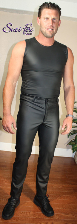 Mens Muscle Tee Shirt shown in Black Matte (no shine) Vinyl/PVC Spandex, custom made by Suzi Fox. • Available in matte black (no shine), matte white (no shine), gloss black, white, red, navy blue, royal blue, turquoise, purple, Neon Pink, fuchsia, light pink, black 3D Prism, red 3D Prism, Turquoise 3D Prism, Baby Blue 3D Prism, Hot Pink 3D Prism, and any fabric on this site. • Give us your measurements for a custom fit! • Standard length is 24 inches (61 cm) for sizes XXXS-Medium; 27 inches (68.6 cm) for sizes Large and up. • Optional add extra length to the shirt. • Made in the U.S.A.