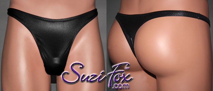 Mens Smooth Front, Wide Strap, T-Back thong - shown in Black Wetlook Lycra Spandex, custom made by Suzi Fox. • Available in black, white, red, turquoise, navy blue, royal blue, hot pink, lime green, green, yellow, steel gray, neon orange Wet Look or any fabric on this site. • Standard front height is 9 inches (22.9 cm). • Available in 4, 5, 6, 7, 8, 9, and 10 inch front heights. • Wear it as swimwear OR underwear! • Made in the U.S.A.