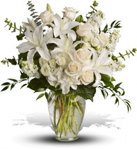 Dreams from the Heart Bouquet with white hydrangea, white spray roses, white stock, pale peach, creme roses or white roses, eucalyptus and foliage in a tall glass vase in Rockville MD, Palace Florists