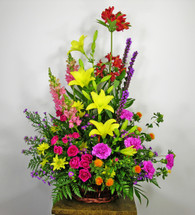 Garden Delight showcases a basket of flowers such as lilies, snapdragon, daisies, liatris and roses in Washington DC and Rockville MD, Palace Florists
