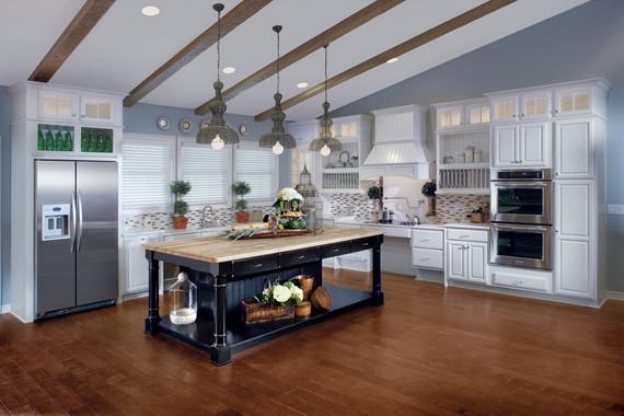 maple kitchen in canvas with cherry island in vintage onyx 5 benefits of kitchen islands kraftmaid
