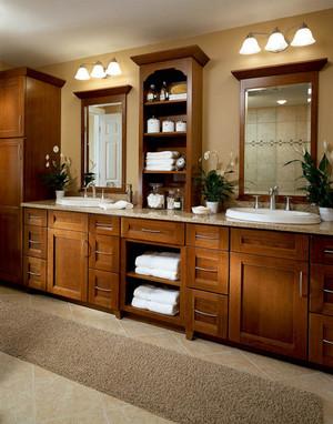 Cherry bathroom in cognac kraftmaid for Kraftmaid closet systems