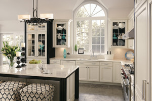 Glass doors with contrasting back panels create a dramatic backdrop for putting favorite serving pieces on distinctive display.