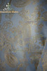 Detail View (polyester damask in light blue with golden pattern)