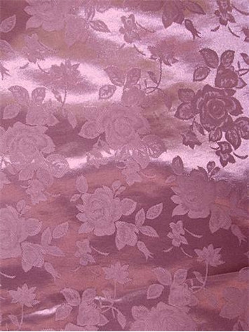 "100% poly washable floral jacquard fabric. High luster soft satin. Perfect for brides maid dress, formal gowns or party decorating fabric for tables, chairs or room decorating. 54"" wide"