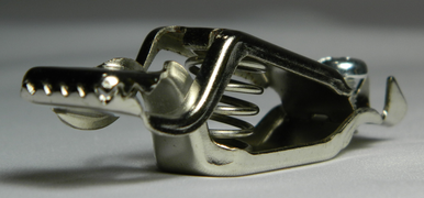 Alligator/Crocodile Clip Replacement clip for Foil, Epee, Saber body cord that attaches to the Lame. In addition, can also be used as a replacement part for a straight or curly mask cord. Angle view