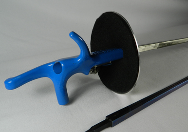 Adult Foil Complete Electric Weapon, StM/FIE Blue Blade. is a high quality electric weapon made with an spring steel alloyed.  Similar to what is use in aircraft.  There is a thin blue coding on the StM blade to help reduce the speed of corrosion making the blade rust resistance, giving the blade a longer life expectancy. This weapon is for the more serious competitor.  Each weapon is built to the desire of the fencer.