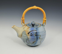 Vintage blue teapot with bamboo handle