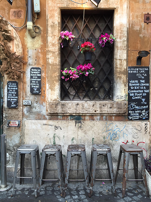 The rustic charm of the weathered facade & cobblestone make this floral window display even more vibrant—Rome, Italy—Happy Easter from The Flower Lady, Milwaukee Florist!