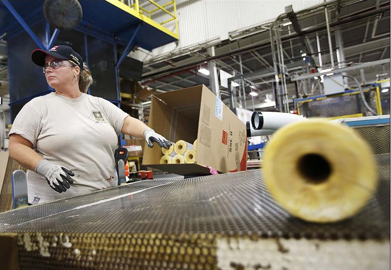 Owens corning facility in newark a tight knit family buy wrap operator malissa moran waits for a tube of pipe insulation while she boxes product in the pipe factory at owens cornings flagship plant in central publicscrutiny Gallery