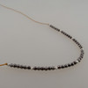 """4"""" Halo of micro faceted 2mm (TINY!) hematite on our golden brown bonded microfiber....sterling accents"""