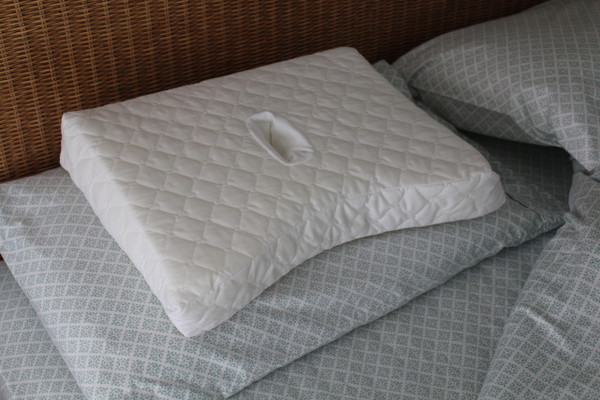The CNH Pillow can be placed on top of another pillow for added height.