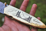 "DKC-70 GOLDEN GATE BRIDGE BRASS Damascus Folding Pocket Knife Polished Brass 5"" Folded,8.5"" Open 13 Oz very solid sophisticated knife. San Francisco Golden Gate Bridge Custom Engraved DKC Knives ™"