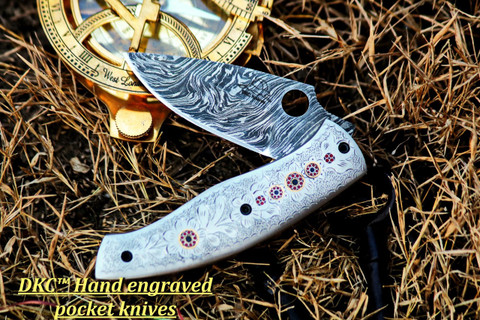 "DKC-619 TEMPEST Damascus Steel Knife Folding Pocket Knife Hand Engraved 8"" Long, 3.5"" Blade 4.5"" Closed 12 oz DKC Knives See similar DKC Knives Forest Dreams & Tempest LUXO Series"