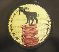 """Brito (Yamilys Brito Jorge) #3319. """"Seria: Dimelo cantando,"""" 2002. Mixed media lithograph print edition 1/1. Sheet music on vinyl record, 7"""" diameter."""