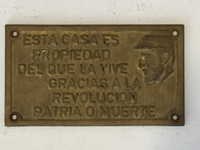"Unkown (SL) ""Esta Casa es proiedad del que la vive gracias a la revolucion patria o muerte,"" N.D. Bronze. 4.5 x 8 inches. NFS"
