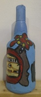 Fuster (José Rodríguez Fuster) #6510BX.  Untitled, 2007. Mixed media on glass bottle. 11 x 4 inches.