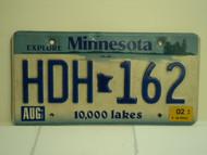 2002 MINNESOTA Explore 10,000 Lakes License Plate HDH 162