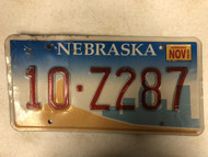 2002 NEBRASKA Platte County License Plate 10-Z287 City Silhouette