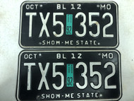 Pair of DMV Clear October 1992 MISSOURI Show-Me State Beyond Local >12,000 LBs LLC License Plates YOM Clear TX5-352 MO