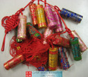 "Chinese New Year Decorative Firecrackers (Firecrackers (w/different colors) were made with silk) size 35"" Long (measured from top of first cracker to bottom of the last cracker) (WX96)"