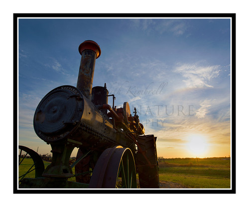 Sunrise Beyond an Antique Tractor in Salina, Kansas 2676