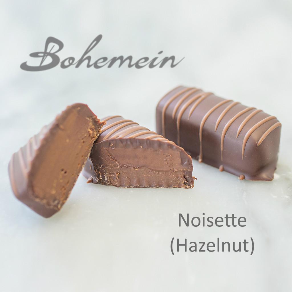 Bohemein Noisette (Hazelnut). A smooth, rich, very nutty blend of Dark 70% chocolate and strong hazelnut praline. Dairy FREE