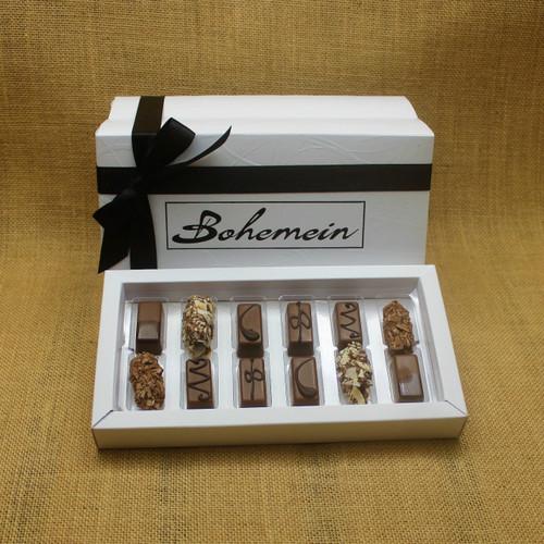 Bohemein 12 Milk Chocolates Gift Box includes: Chocolate Caramel x 2, Amaretto Truffle x 2, Cointreau Ganache x 2, Vanilla Cream - Milk x 2  Maple Cream x 2, Coffee Truffle x 2