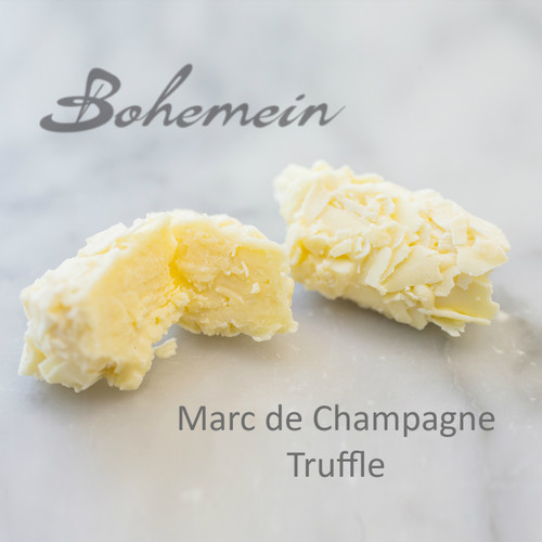Bohemein Marc de Champagne Truffle. A white chocolate delight. Sweet White chocolate truffle with a hint of the flavour of Bubbly wine. Dipped and rolled in more white chocolate.