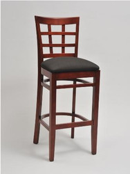 Made from solid beechwood, Seats and Stool's Window Pane Bar Stool is perfect for any restaurant, bar, home, or hotel. Finish options include mahogany, cherry, or walnut finish. The upholstered seat is available in a wide range of vinyls and fabrics to match your decor.