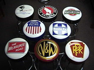 "Express your love of trains with our Train Bar Stools, which make great additions to your bar, rec room, garage, pool hall, or restaurant. Each stool has your favorite railroad on the padded seat top and you can customize the sideband with your name or business. Logos are printed on the underside of clear vinyl so they won't rub off. All stools feature a 360-degree swivel and durable chrome frame in 30"" or 24"" height.  Top Row: Chesapeake & Ohio, Great Northern Railway, Chicago & Northwestern Middle Row: Union Pacific, Santa Fe Bottom Row: The Milwaukee Road, Norfolk & Western, Pennsylvania Railroad"