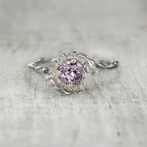 pink sapphire engagement ring with diamond halo.