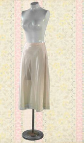 'Snip It' taffeta slip with tags from the 1950s
