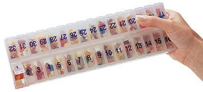 32-Day, 1 Compartment Per Day Medication Organizer filled with pills.
