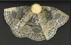 Ivory Lace Headcovering With Carnation
