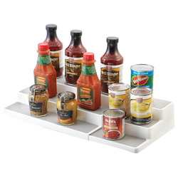 It has a stepped design with an expandable width. The shelf riser is adjustable to accommodate for the user.