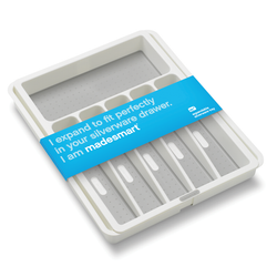 Expandable silverware tray with non skid feet and anti-bacterial overmold.